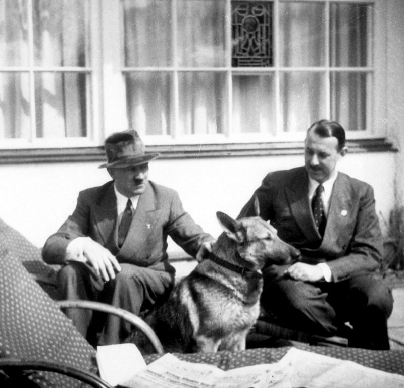 Adolf Hitler in conversation with Hermann Esser on the Berghof terrace, from Eva Braun's albums