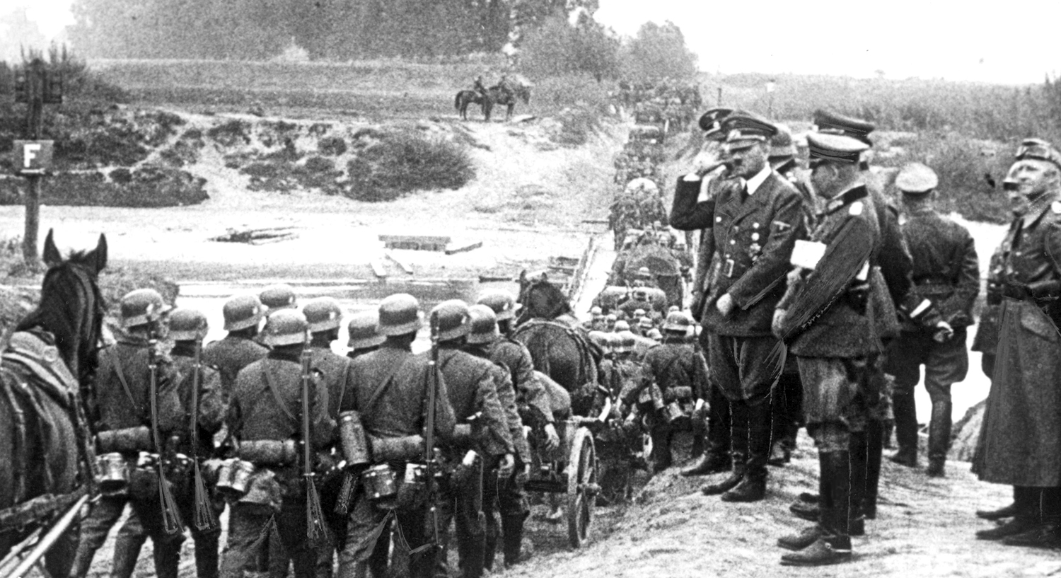 Adolf Hitler salutes his troops near Ubieszyn as they are crossing the Vistule river
