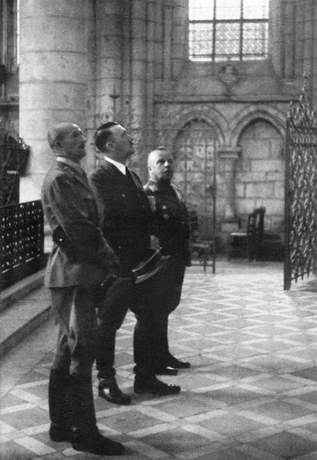 Adolf Hitler visits the cathedral of Laon, France, with his war comrades Max Amann and Ernst Schmidt