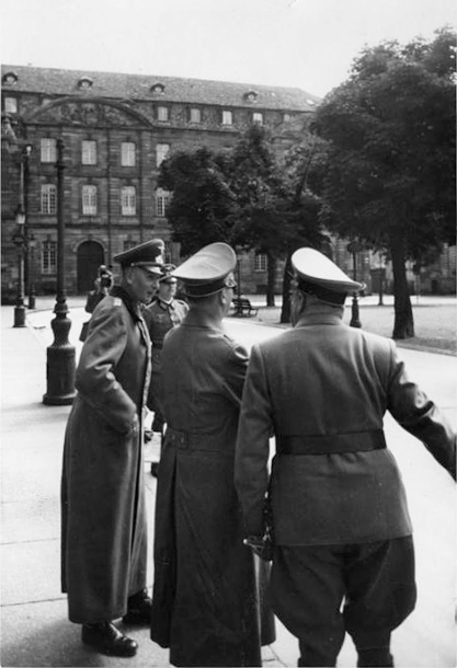 Adolf Hitler leaves the Strasbourg cathedral after his visit