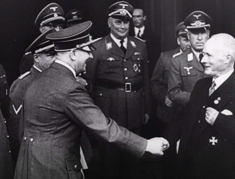 Adolf Hitler greets Gustav Krupp in front of his Essen estate on the occasion of his 70th birthday
