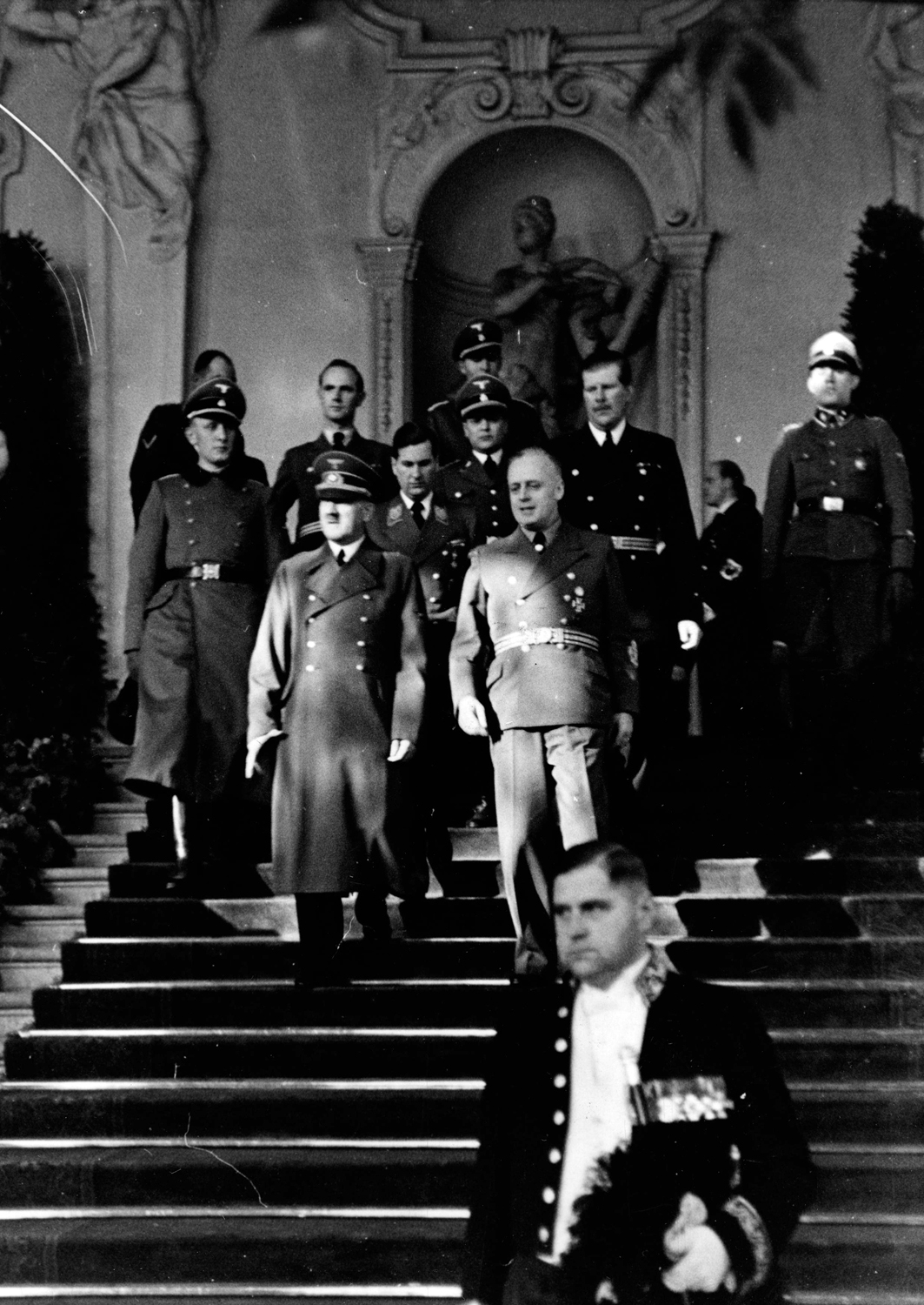Adolf Hitler and Joachim von Ribbentrop leave Vienna's Belvedere Palace after Hungary joined the Tripartite Pact