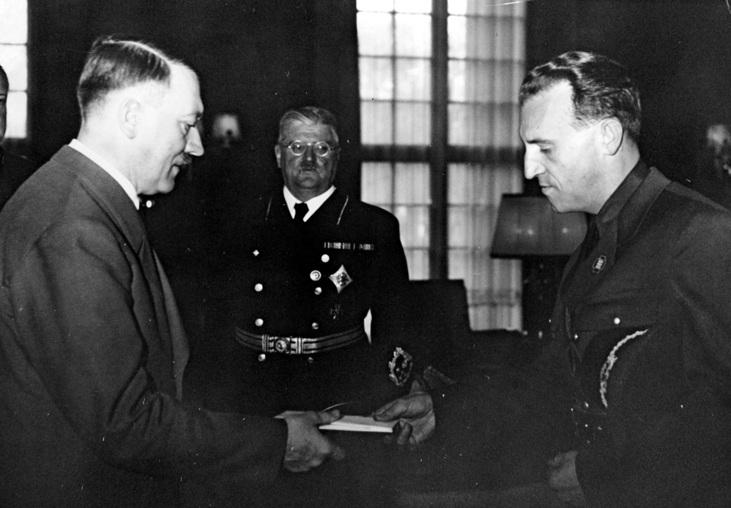 Adolf Hitler receives Romanian diplomat Constantin Grecianu in Berlin, with the secretary of state Otto Meisner between them