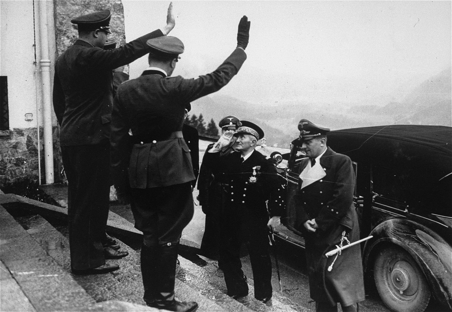 Adolf Hitler salutes Admiral Francois Darlan upon his arrival at the Berghof