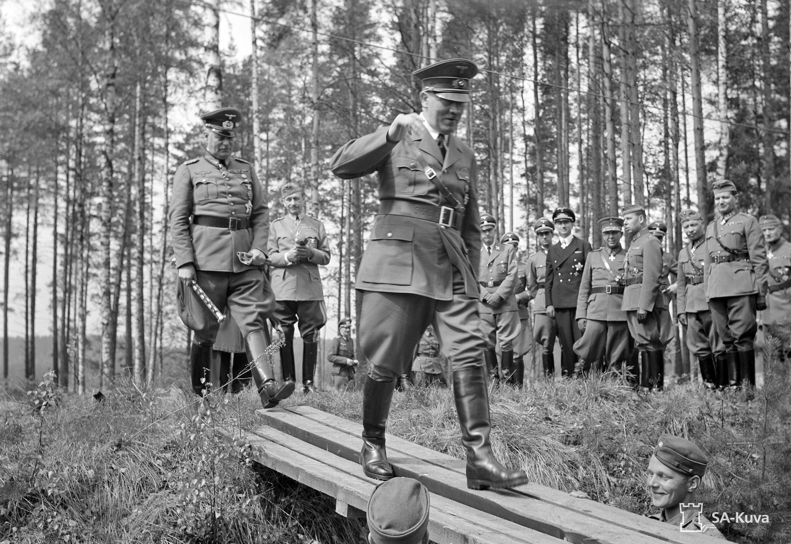 Adolf Hitler walks the plank followed by Marshal Keitel to get access to Mannerheim's train in Finland for Mannerheim 75th birthday