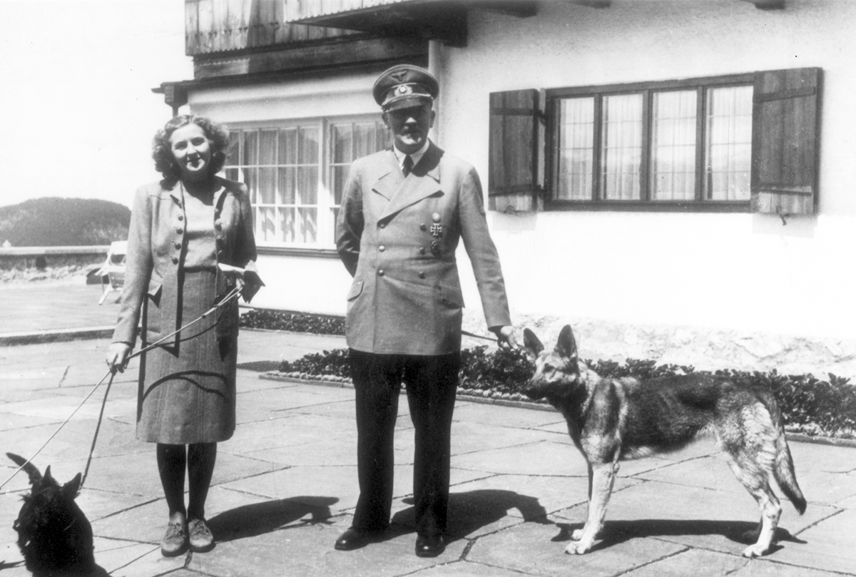 Adolf Hitler and Eva Braun, with their dogs at the Berghof, from Eva Braun's albums