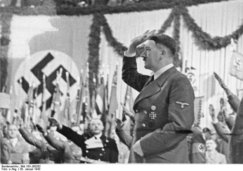 Adolf Hitler salutes after his speech in Berlin's Sportpalast