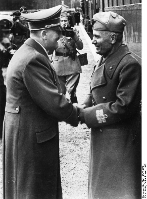 Adolf Hitler greets Benito Mussolini at his arrival in Kleßheim station